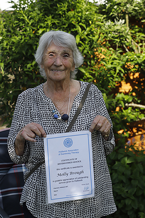Molly brough holding up certificate